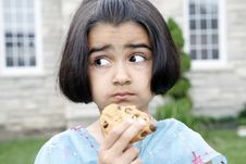 Little Girl Enjoying Cookie Royalty Free Stock Photos