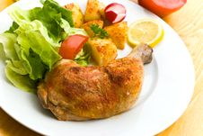 Fried Chicken With Fried Potatoes,lettuce And Toma Stock Photo