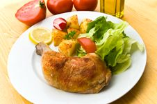 Fried Chicken With Fried Potatoes,lettuce And Toma Stock Photography