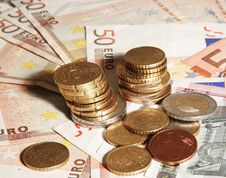 Euro Paper Currency And Euro Coins Royalty Free Stock Photography