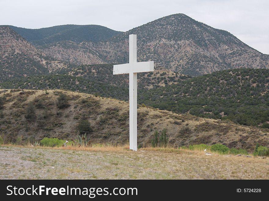 Cross isolated in the desert