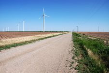 Wind Turbines By Country Road Royalty Free Stock Images