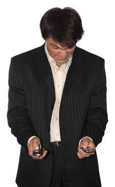Free Angry Businessman Holding Two Mobile Phones Stock Image - 5735461