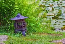 Japanese Lantern Near Lily Pond Royalty Free Stock Photos