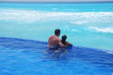 Father And Daughter Swimming Stock Photo