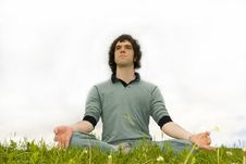 Free Man Sitting In The Lotus Posture Royalty Free Stock Photo - 5739315