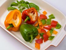 Free Three Peppers Cut In Preparation. Stock Image - 5739661
