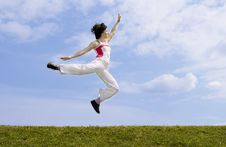 Free Girl Jumping On The Grass Royalty Free Stock Images - 5739859