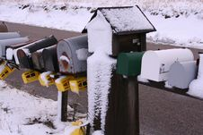 Free A Row Of Snowy Mailboxes Stock Image - 5740431
