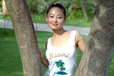 Chinese Girl Between Branches Royalty Free Stock Images