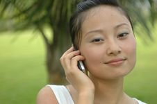 Free Chinese Girl Using Mobile Phone Stock Photography - 5742742