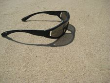 Free Solar Glasses On Sand Royalty Free Stock Photography - 5744357