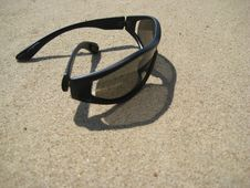 Free Solar Glasses On Sand Stock Photos - 5744363