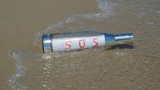 Free Message In A Bottle With SOS Signal Royalty Free Stock Image - 5744796