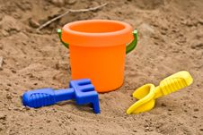 Free Toys In Sand Stock Image - 5751641