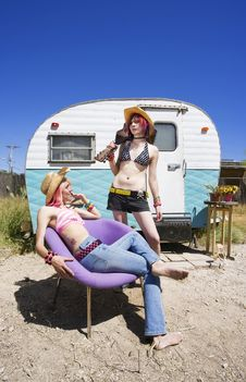 Free Young Women In Front Of A Trailer Royalty Free Stock Photography - 5751807