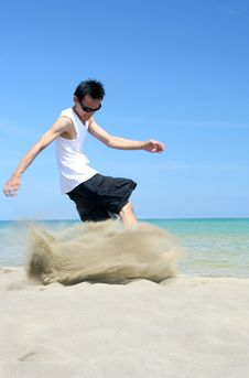 Kicking The Tropical Beach Sand Stock Photo