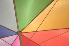 Free Under A Brightly Colored Umbrella Stock Images - 5752794