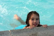 Free Girl Holding Onto Edge Of Pool Royalty Free Stock Images - 5753119