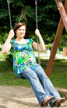 Free Pregnant Woman On Swing Royalty Free Stock Photos - 5755588