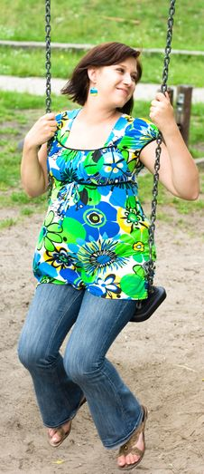 Free Pregnant Woman On Swing Stock Photography - 5755602