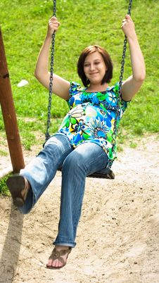 Free Pregnant Woman On Swing Royalty Free Stock Images - 5755649
