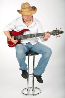 Guitar Man With Hat On Chair Stock Images