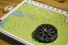 Navigation Compass And Map Stock Photo