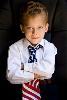 Young Boy Wearing A US Flag Necktie