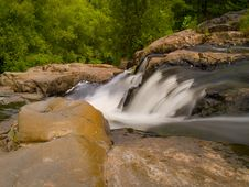 Rapids Falling Into The Forest Royalty Free Stock Photography