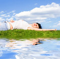 Free Woman Rest On The Green Grass Royalty Free Stock Photography - 5762487
