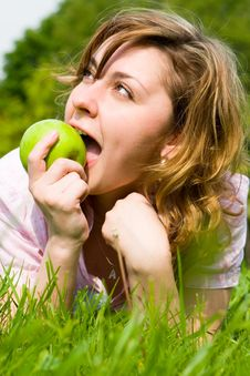 Free Pretty Woman Eating Green Apple Stock Images - 5761934
