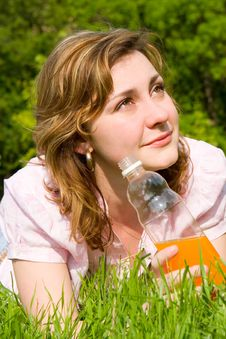 Free Woman Drinking Juice On The Summer Glade Royalty Free Stock Photos - 5762138