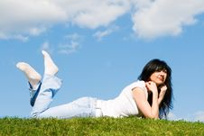 Woman Rest On The Green Grass Royalty Free Stock Photos