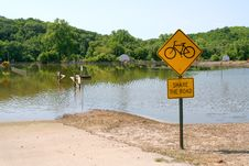 Share The Road Sign With Flood Stock Photo