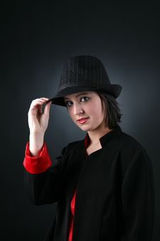 Pretty Teen In Black And Red And Top Hat Royalty Free Stock Photos