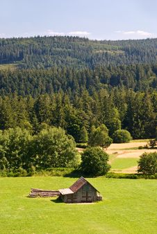 Free A Field And A Few Old Cottages In The Swiss Alps Stock Photography - 5763452