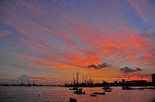 Sunset, Cloud And Boat At The Seaside Royalty Free Stock Photo