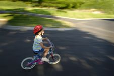 Free Little Girl Riding A Bike Stock Photos - 5764463