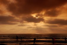 Free Orange Sunset With Beach Goers Royalty Free Stock Image - 5766656