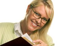 Free Smiling Woman Reading A Book Stock Photo - 5767430