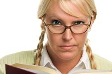 Free Serious Blonde With Ponytails Reads A Book Stock Images - 5767524