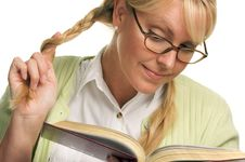 Cute Blonde Plays With Ponytails & Reads A Book Stock Photo