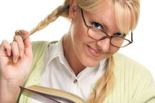 Blonde Plays With Ponytails & Reads A Book Stock Photo