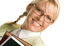 Cute Student Carries Stack Of Books Royalty Free Stock Photo