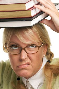 Unhappy Woman Carries Stack Of Books Royalty Free Stock Photo