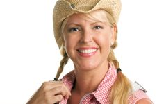 Attractive Blond With Cowboy Hat Royalty Free Stock Photography