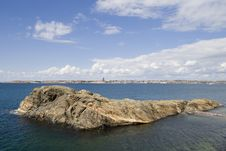 Coastal Island In Sunlight Stock Image