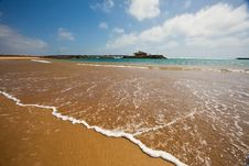 A Beach With A Pier Royalty Free Stock Photos