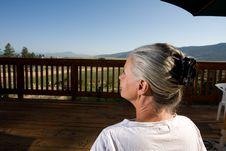Free Senior Woman Sitting By Pool Stock Image - 5768991